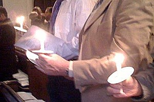 candles held during a candlemas church service